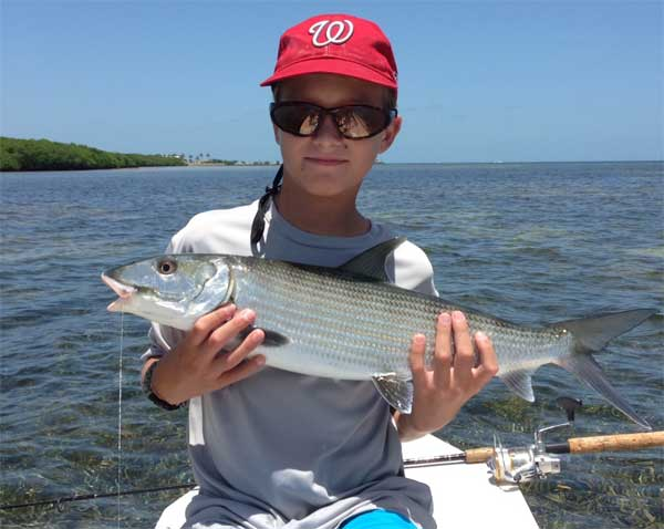 mason with a nice bonefish on spin rod
