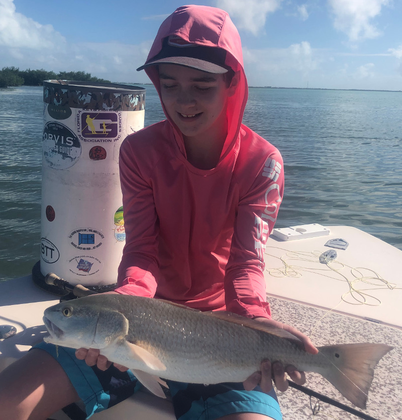 11 yr old catches her first fish